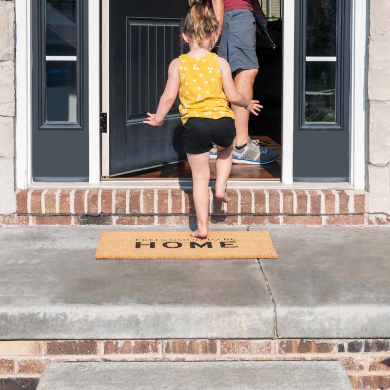 Girl walking into house